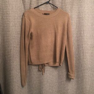 Black and tan sweaters